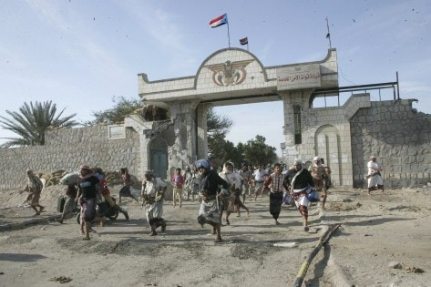 Militia men loyal to Yemen's President Abd-Rabbu Mansour Hadi loot the barracks of the Special Forces in Aden