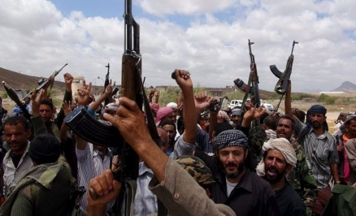 Southern People's Resistance militants loyal to Yemen's President Hadi celebrate seizing the al-Anad air base in the country's southern province of Lahej
