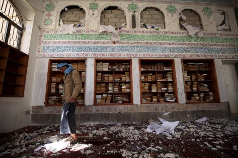 Houthi militant looks on after a suicide bomb attack at a mosque in Sanaa