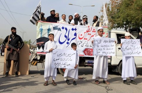 Supporters of the Jamaat-ud-Dawa Islamic organization hold placards during a demonstration in support of Saudi Arabia over its intervention in Yemen, in Islamabad