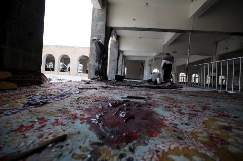 Blood is seen on the ground after a suicide bomb attack at a mosque in Sanaa