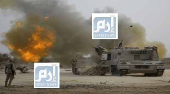 Saudi army artillery fire shells towards Houthi movement positions at the Saudi border with Yemen
