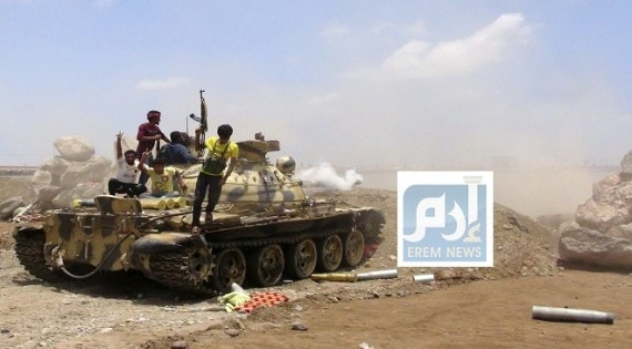 Militants loyal to Yemen's President Abd-Rabbu Mansour Hadi stand on a tank in the country's southern port city of Aden