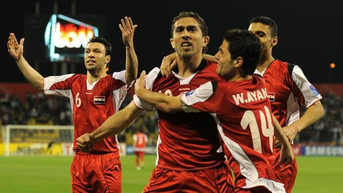 Syria's players celebrate after forward