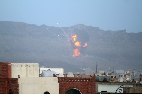 An explosion is seen at the Noqum Mountain after it was hit by an air strike in Yemen's capital Sanaa