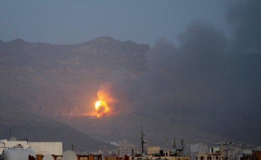 Fire is seen from the Noqum Mountain after it was hit by an air strike in Yemen's capital Sanaa