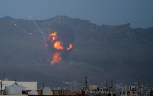 An explosion is seen from the Noqum Mountain after it was hit by an air strike in Yemen's capital Sanaa