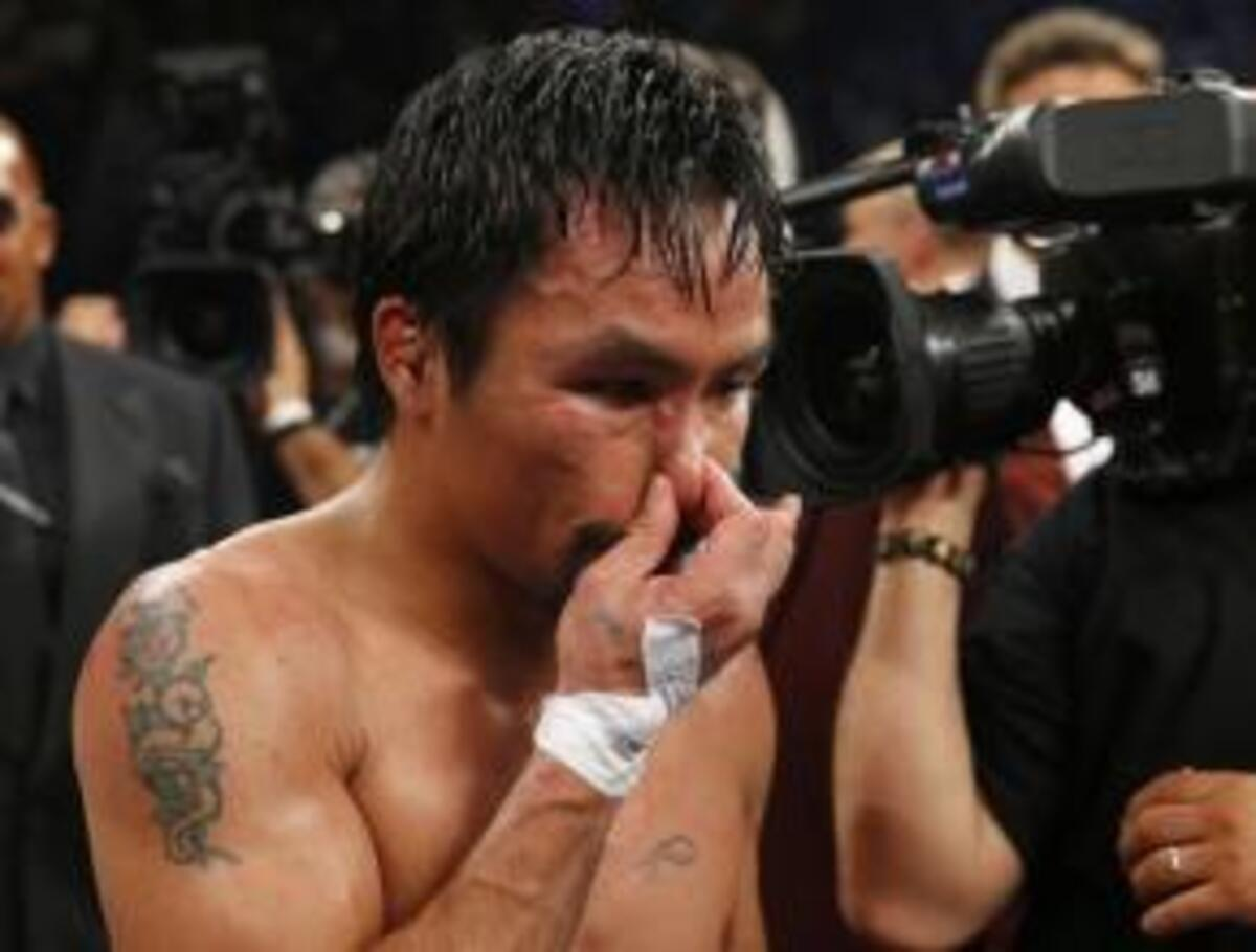 Pacquiao of the Philippines reacts after losing to Mayweather, Jr. of the U.S. following their welterweight title fight in Las Vegas
