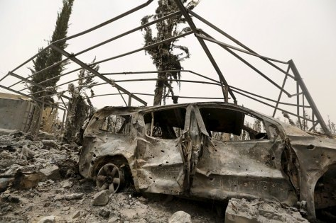 Destroyed car is seen near the house of General Ali al-Dhafif, a Yemeni army brigade commander, after it was hit by Saudi-led air strikes near Sanaa, Yemen