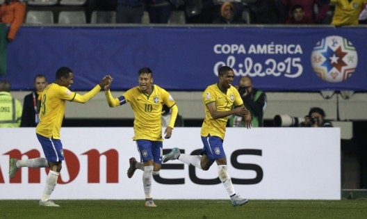 Brazil's Douglas celebrates his goal against Peru with teammates Neymar and Elias during their first round Copa America 2015 soccer match at Estadio Municipal Bicentenario German Becker in Temuco