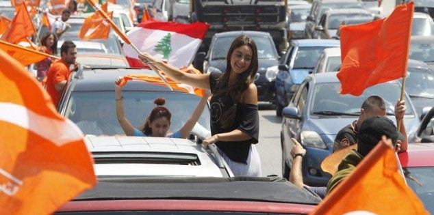 Supporters of the Free Patriotic Movement carry flags during protest in Beirut, Lebanon
