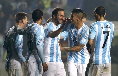 Argentina's Gonzalo Higuain celebrates with teammates after scoring a goal against Paraguay during their Copa America 2015 semi-final soccer match at Estadio Municipal Alcaldesa Ester Roa Rebolledo in Concepcion