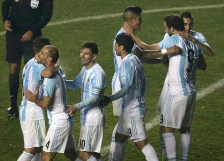 Argentina players, including Argentina's Lionel Messi, celebrate after defeating Paraguay in their Copa America 2015 semi-final soccer match at Estadio Municipal Alcaldesa Ester Roa Rebolledo in Concepcion