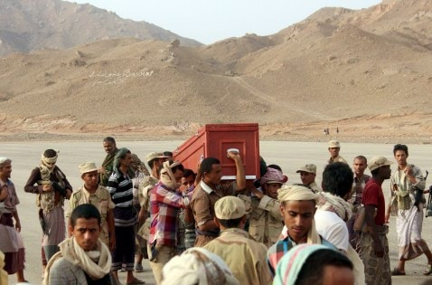 Relatives carry the coffin of a Yemeni soldier killed by Saudi-led air strikes on an army base that was hit in error, during a funeral procession in al-Abr on the border with Saudi Arabia