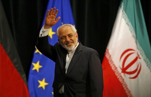 Iranian FM Zarif waves after a plenary session at the United Nations building in Vienna