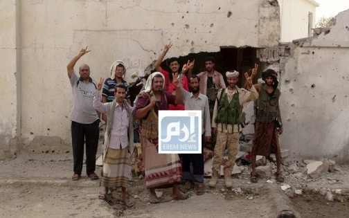Southern Resistance fighters flash the victory sign at the international airport of Yemen's southern port city of Aden