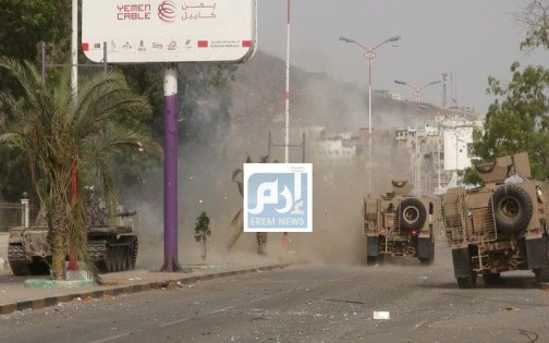 Military vehicles of the Southern Resistance fighters move during clashes with Houthi fighters on a street in Yemen's southern port city of Aden