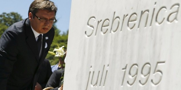 Serbian Prime Minister Vucic places flowers during a ceremony marking the 20th anniversary of the Srebrenica massacre in Potocari