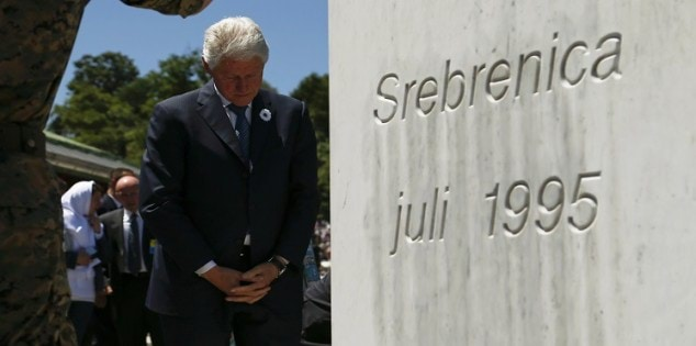 Former United States president Clinton observes a moment of silence during a ceremony marking the 20th anniversary of the Srebrenica massacre in Potocari