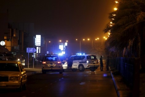 Police cars block the Budaiya highway leading to the blast site where one police officer was killed late Friday evening in Budaiya west of Manama