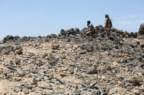 Fighters loyal to Yemen's government take position during fighting against Houthis in the frontline province of Marib
