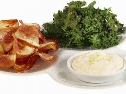 Potato and Kale Chips are served with dipping sauce.