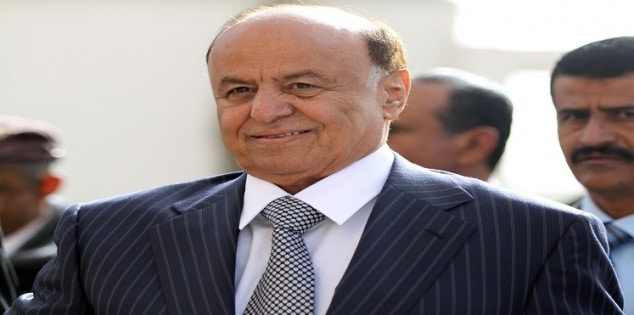 Yemen's Vice President Abd-Rabbu Mansour Hadi smiles before casting his vote at a polling station in Sanaa