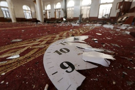 Part of a wall clock is seen at a mosque hit by two bombings in Yemen's capital Sanaa