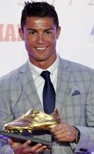 Real Madrid's striker Cristiano Ronaldo poses with his Golden Boot trophy during a ceremony in Madrid, Spain