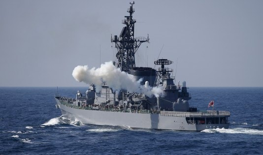JMSDF destroyer Shimakaze fires its cannon during a fleet review at Sagami Bay, off Yokosuka