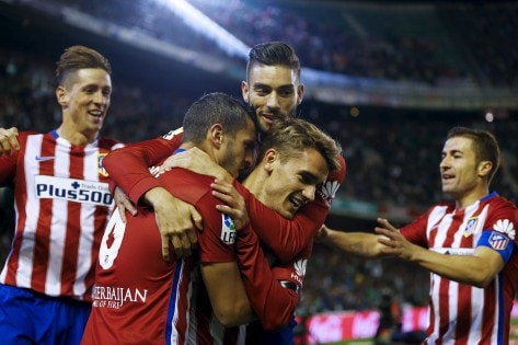 Atletico Madrid's Koke is congratulated by team mates after scoring against Real Betis