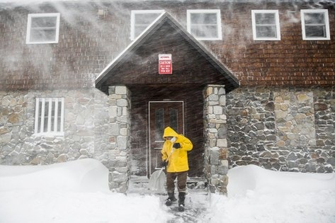 Craig Bentley, caretaker of Soda Springs Station, shovels snow in Soda Springs