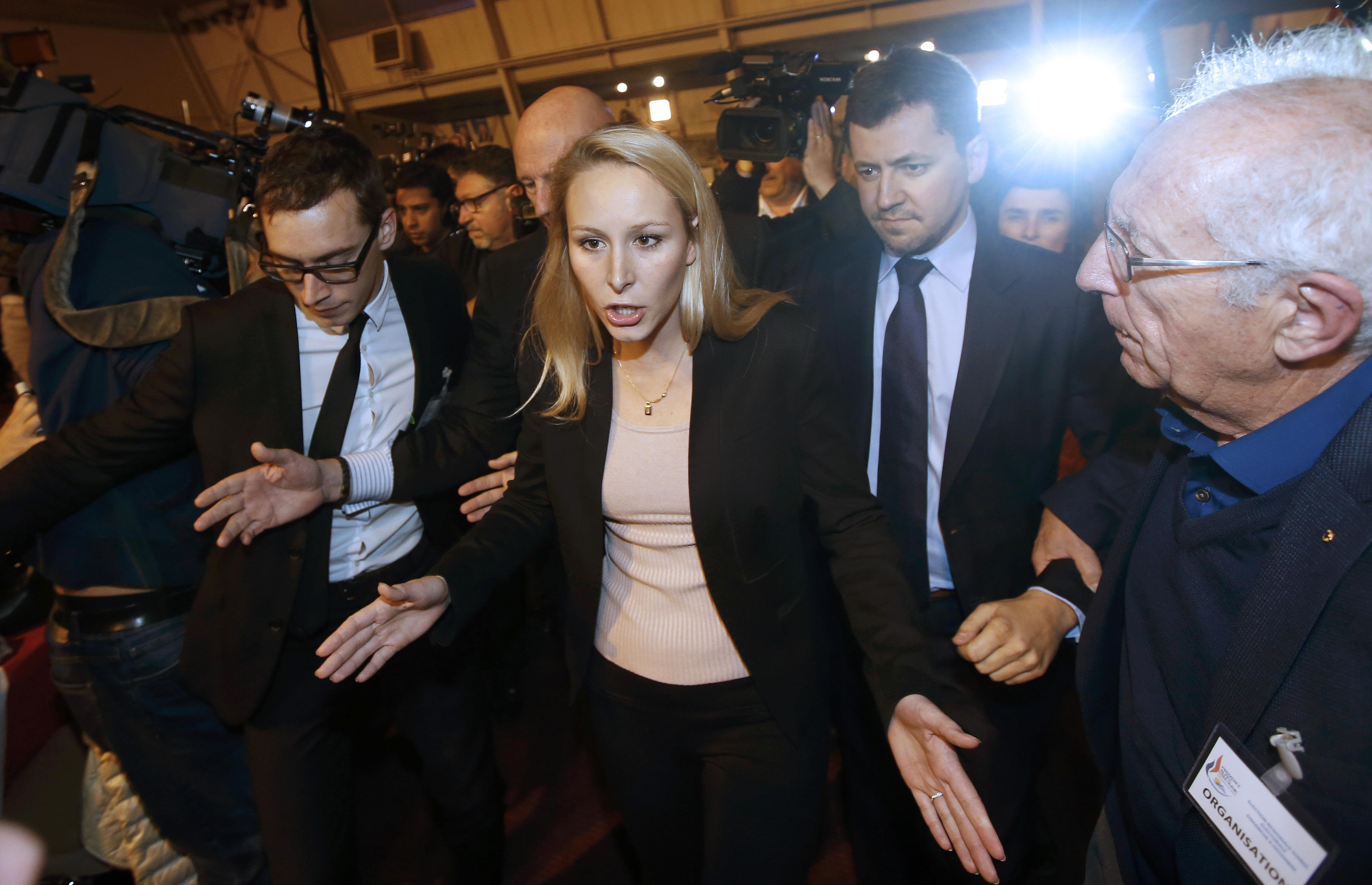 Marion Marechal-Le Pen, French National Front political party member and candidate for National Front in the Provence-Alpes-Cote d'Azur (PACA) region reacts after the announcement of the results of the first round of the regional elections in Le Pontet