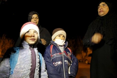 Residents who say they have received permission from the Syrian government to leave the besieged town depart after an aid convoy entered Madaya
