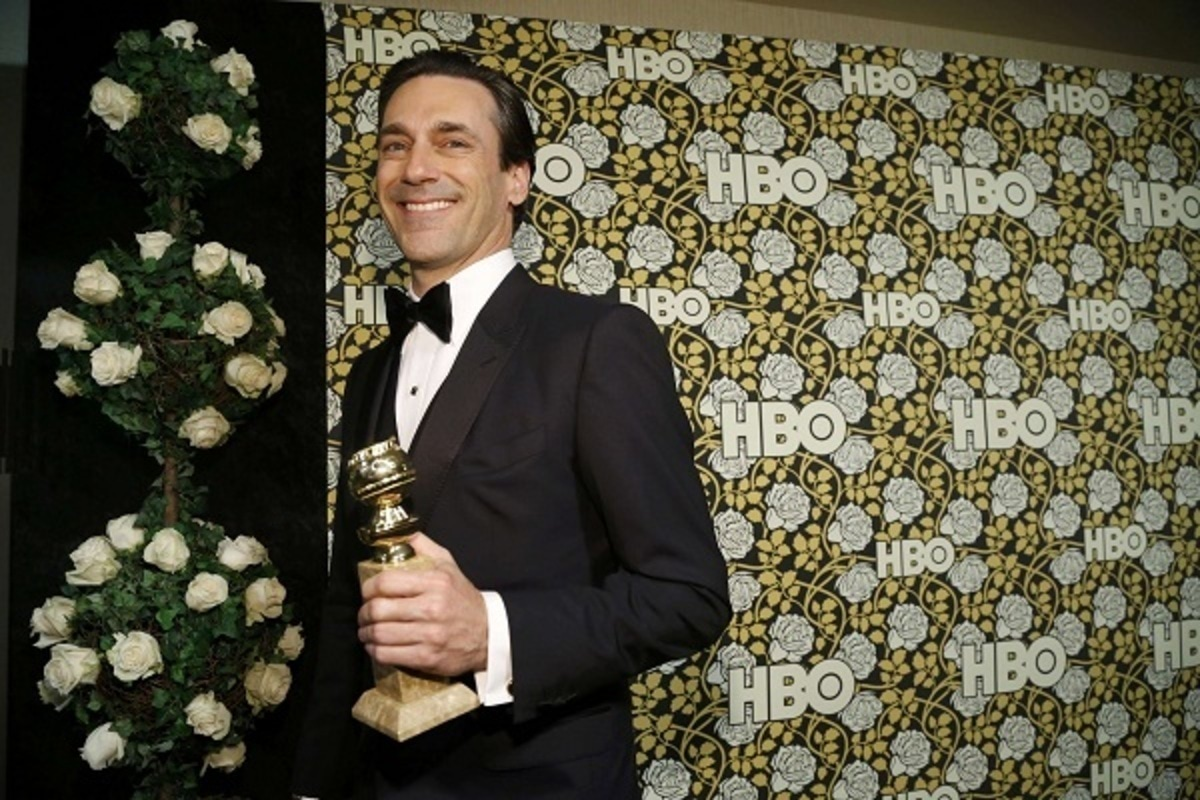 "Actor Jon Hamm carries his award for Best Performance by an Actor In A Television Series - Drama for his role on ""Mad Men"" as he arrives at The HBO Golden Globe After Party in Beverly Hills"