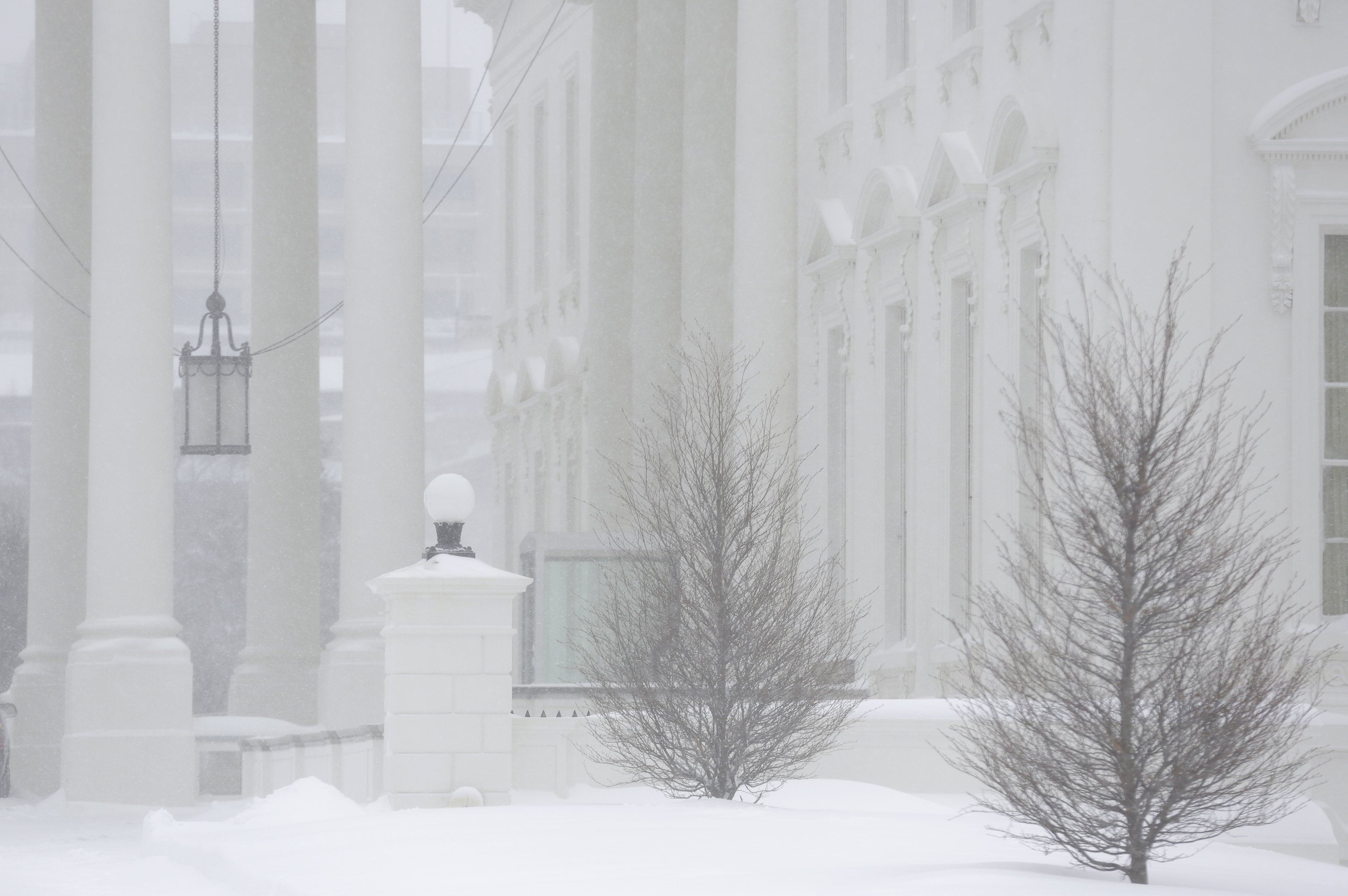 The White House grounds are covered in snow during a winter storm in Washington