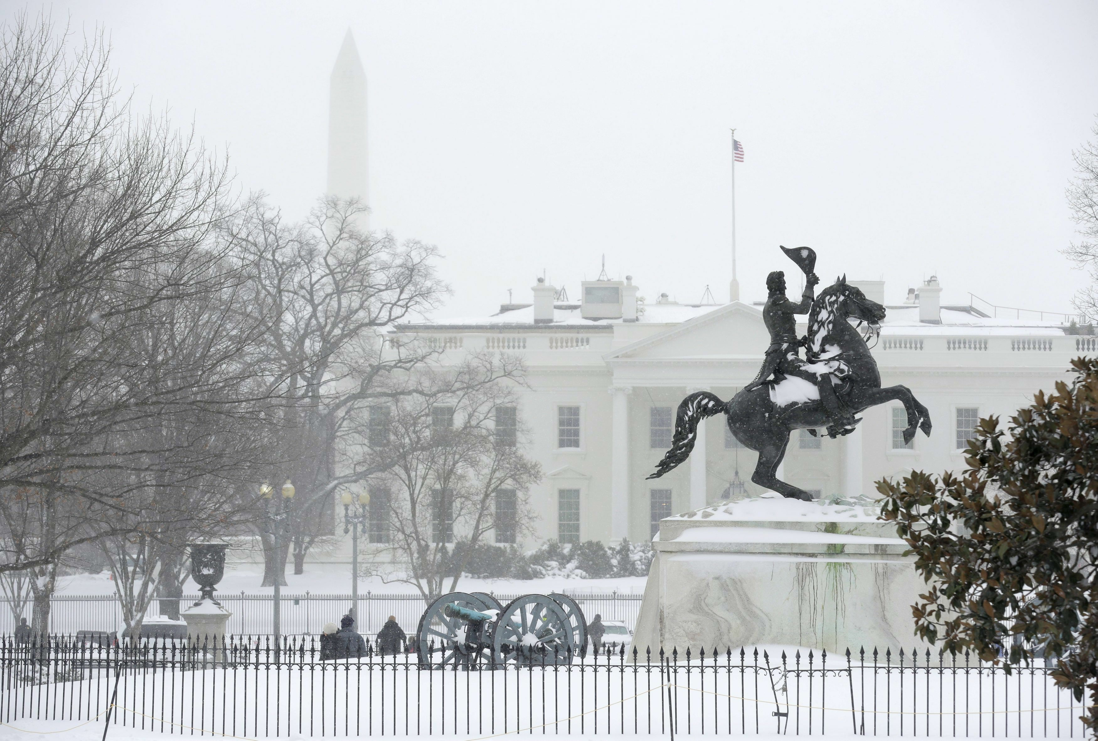 The statue of Pierre Charles L'Enfant is coated in snow during a winter storm in Washington January