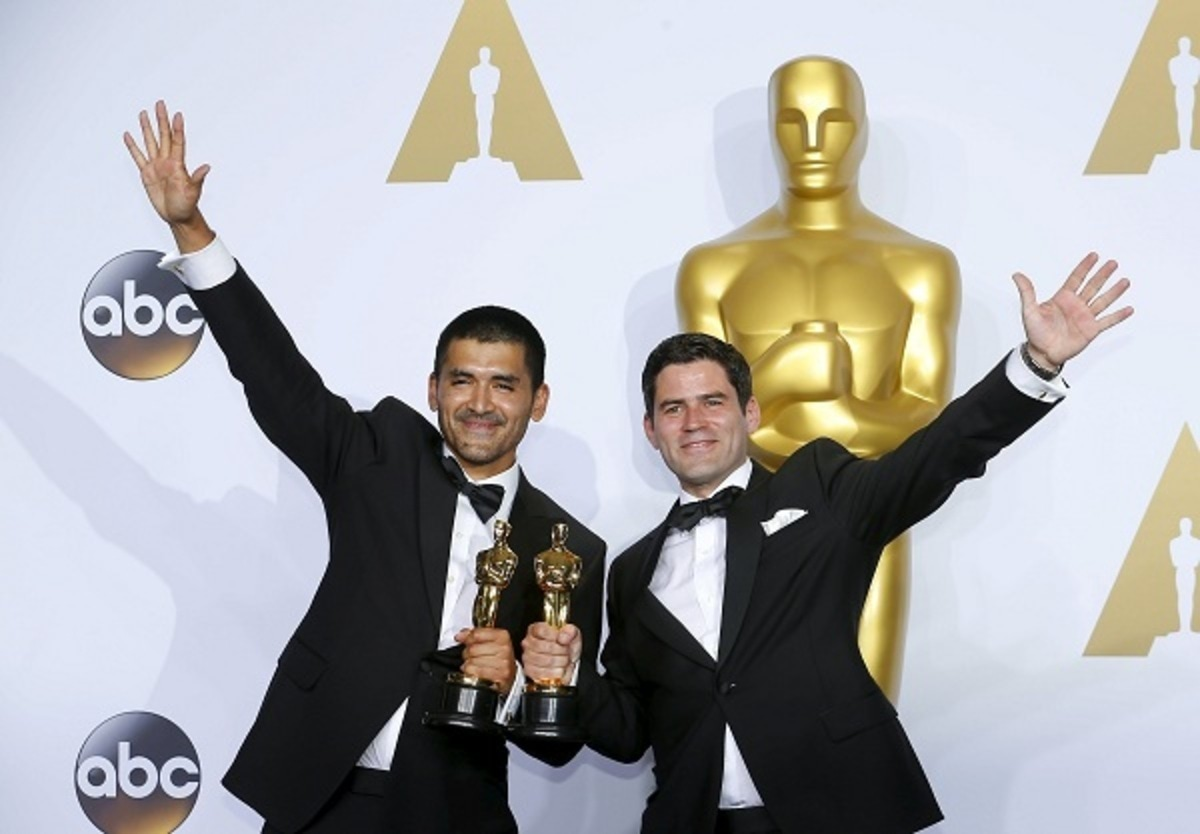 """Pato Escala (R) and Gabriel Osorio celebrate after winning the Oscar for Best Animated Short Film for """"Bear Story"""" backstage during the 88th Academy Awards in Hollywood, California"""