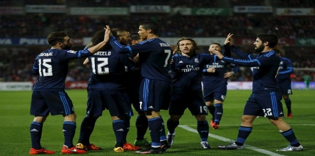 Real Madrid's Karim Benzema is congratulated by team mates after scoring against Granada