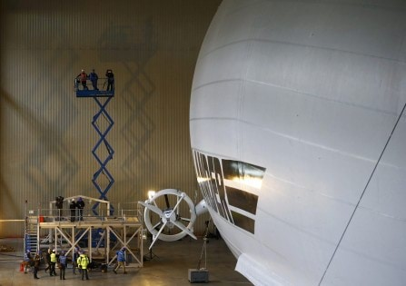 Members of the media film the Airlander 10 hybrid airship during its unveiling in Cardington