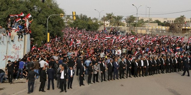 Supporters of prominent Iraqi Shi'ite cleric Moqtada al-Sadr shout slogans during a protest against government corruption outside the Green Zone in Baghdad
