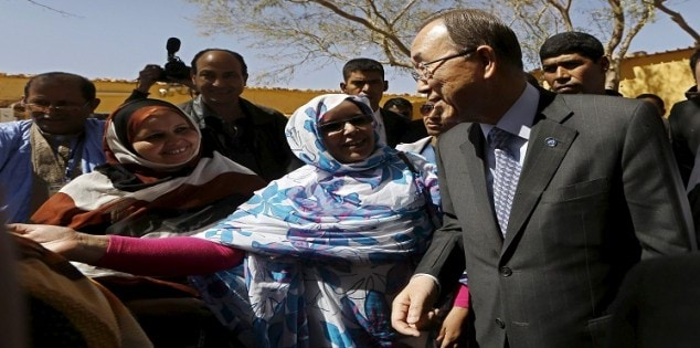 UN Secretary General Ban Ki-moon listens to a member of the Sahrawi women's national union after his press conference at the Sahrawi Arab Democratic Republic presidential palace in Tindouf