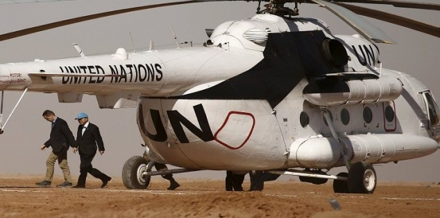 U.N. Secretary General Ban Ki-moon walks out the helicopter as he arrives for a one day visit to the indigenous Sahrawi refugee camp of Al Smara in Tindouf