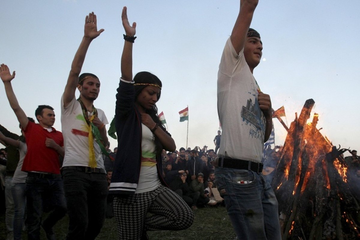 Syrian and Iraqi Kurds celebrate Newroz at a makeshift camp for refugees and migrants near the village of Idomeni
