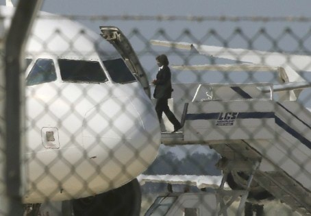 An official boards a hijacked EgyptairA320 Airbus at Larnaca Airport