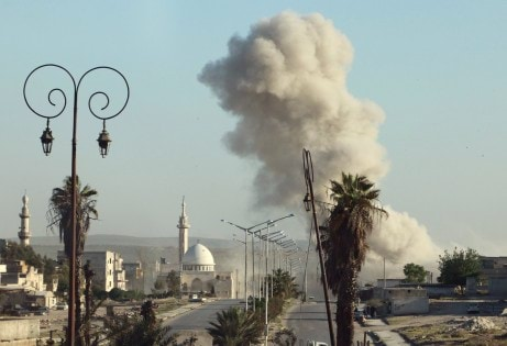 Smoke rises after an airstrike in the rebel held area of old Aleppo