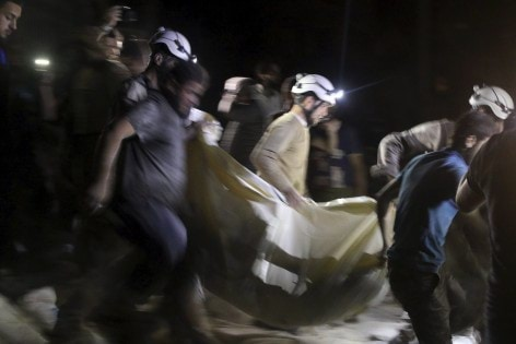 Civil defence members carry a casualty after an airstrike at a field hospital in the rebel held area of al-Sukari district of Aleppo