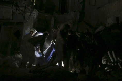 Civil defence members search for survivors after an airstrike at a field hospital in the rebel held area of al-Sukari district of Aleppo
