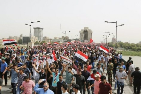 Followers of Iraq's Shi'ite cleric Moqtada al-Sadr take part in a protest in Baghdad