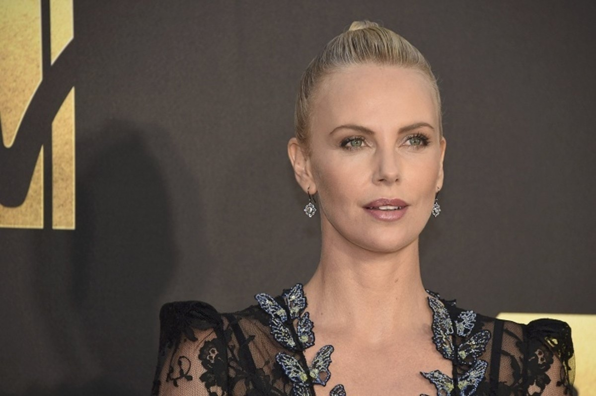 Actress Charlize Theron arrives at the 2016 MTV Movie Awards in Burbank